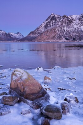 Mountains over a fjord in winter on the Lofoten, Norway