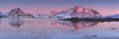 Mountains reflected in the water at sunset