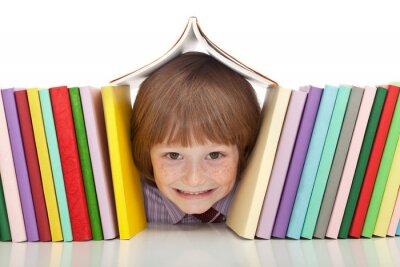 Cuadro Muchacho feliz con los libros de colores