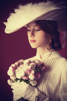 Cuadro Mujer bella pelirroja con el ramo