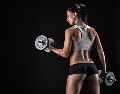 Cuadro Mujer joven que levanta las pesas