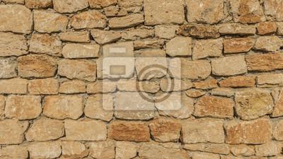 muro de piedra de color beige marrón de la vendimia