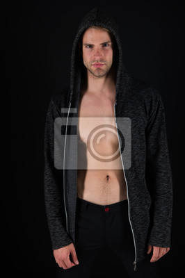 Cuadro Muscular and sexi. Muscular man with athletic chest. Athletic man with muscular chest. Young fit athlete. Sexy sportsman. Handsome man wearing hoody. Healthy and active lifestyle