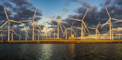 Offshore wind farm at beautiful, dramatic sunset