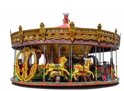 Old fashioned merry-go-round fairground attraction with horses, cart and a slay. Isolated on a white background