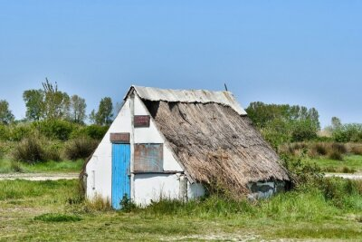 old wooden house in camargue, photo as a background, digital image , aigues mortes