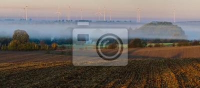 panorama of fields on an autumn foggy morning in German Brandenburg