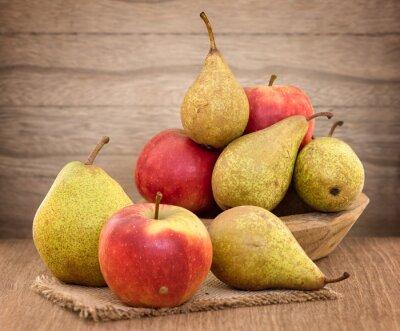 Cuadro Peras y manzanas en la mesa de madera