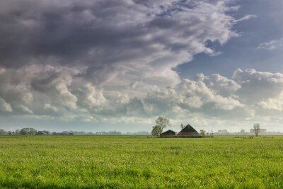 raining sunny day ober Dutch farmland