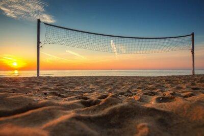 Cuadro Red de voleibol y amanecer en la playa