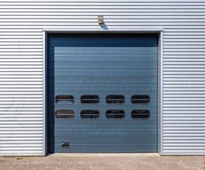 Rool up entrance door to a warehouse with an aluminium facade