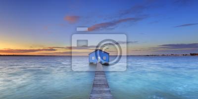 Salida del sol en Matilda Bay boathouse en Perth, Australia