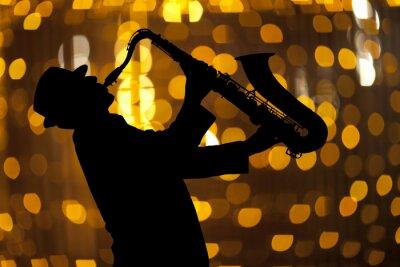 Cuadro Saxofonista. Hombre que juega en el saxofón