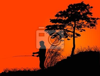 Silueta del pescador en la puesta de sol de color naranja