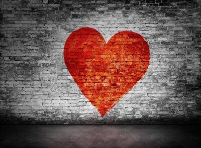 Cuadro Símbolo del amor pintado en pared de ladrillo oscura