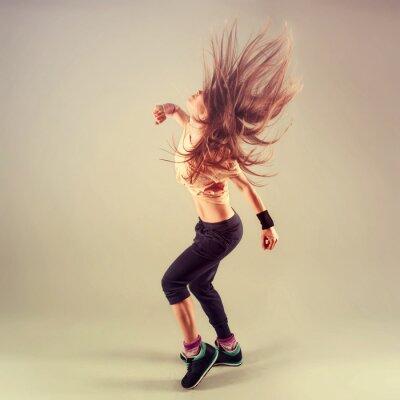 Cuadro Studio shoot of active female funk jazz dancer moving.