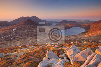 Sunrise over the Mourne Mountains and lakes in Northern Ireland