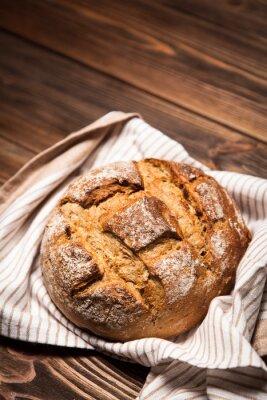 Cuadro Surtido de pan en superficie de madera