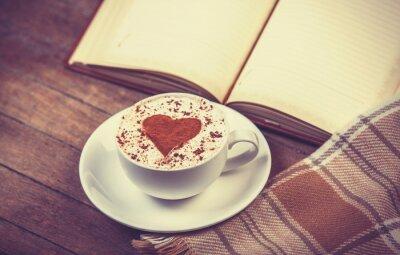 Cuadro Taza de café y un libro con la bufanda
