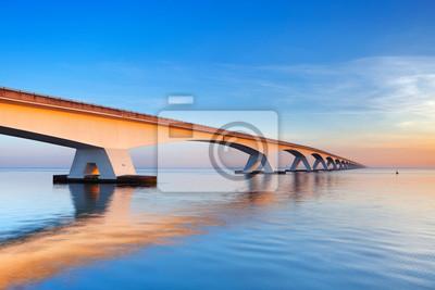 The Zeeland Bridge in Zeeland, The Netherlands at sunrise