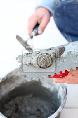 Cuadro Trabajador de la construcción es suelo de baldosas en casa