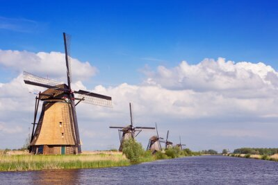Traditional Dutch windmills on a sunny day at the Kinderdijk