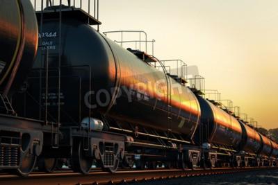 Cuadro Transporte tanque de coches con aceite durante la puesta del sol.