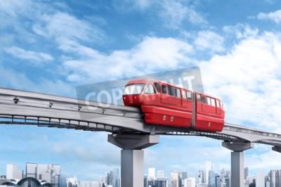 Cuadro Tren de monorraíl rojo contra el cielo azul y la ciudad moderna en el fondo