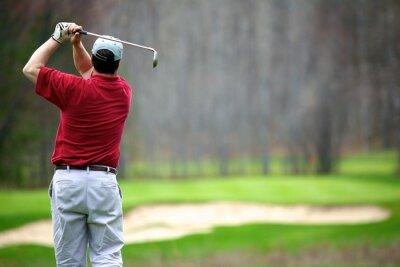 Cuadro Un hombre disfruta de un juego de golf
