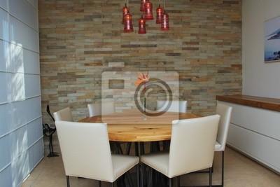 Un moderno, estilizado comedor con una mesa de comedor redonda ...