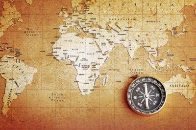 Cuadro Un viejo compás de cobre amarillo sobre un fondo de mapa del tesoro