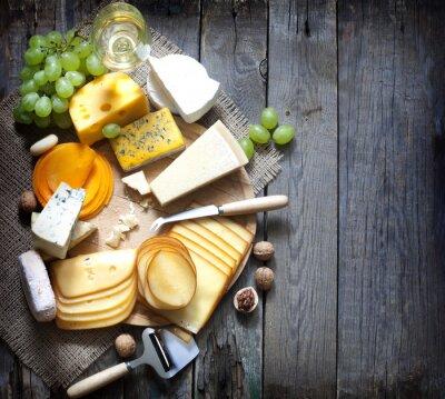 Cuadro Varios tipos de queso con vacío concepto de fondo del espacio