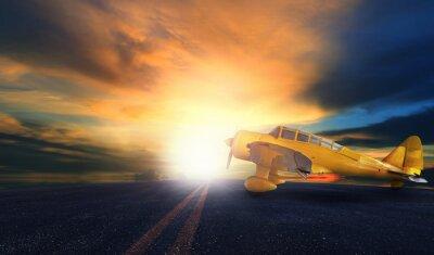 Cuadro Viejo avión de hélice amarillo en la pista del aeropuerto con el cielo puesta de sol bac
