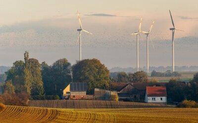 Village in Brandenburg, Germany in autumn scenery. In the background a wind farm