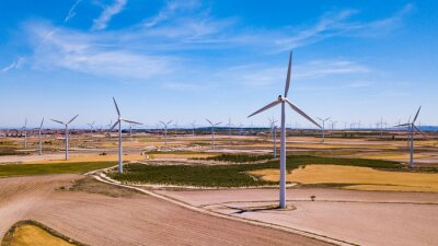 Wind Turbines at farmland in summer near the town of La Muela, Spain