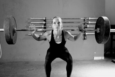Cuadro woman on a weightlifting session - crossfit workout.