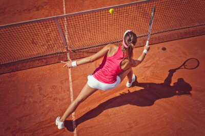 Cuadro Young woman playing tennis.High angle view.Forehand volley.