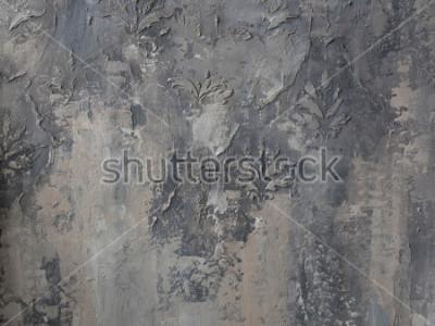 Fotomural adorno en un muro de hormigón gris