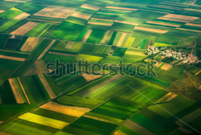 Fotomural aerial photo from a plane, top view, field roads and city