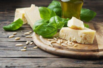 Fotomural Albahaca, queso, pino y aceite de oliva en la mesa de madera