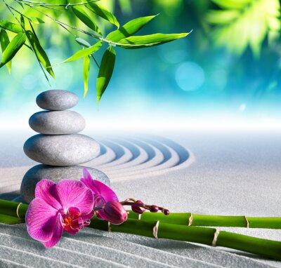 Fotomural arena, orquídeas y piedras de masaje en el jardín zen