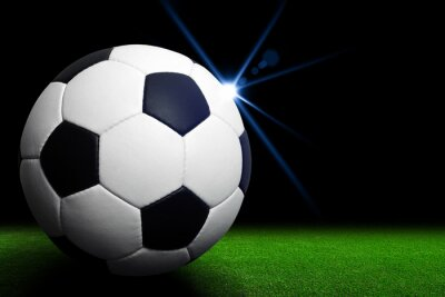 Fotomural Balón de fútbol en el estadio verde