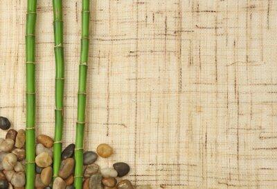 Fotomural bambou et cailloux sur fond de toile de yute