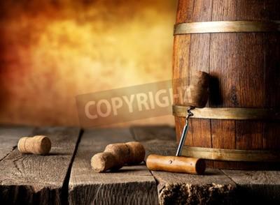 Fotomural Barril con vino y sacacorchos en una mesa de madera