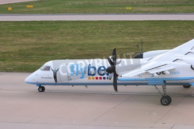 Fotomural BIRMINGHAM, UK - APRIL 24, 2013: Pilots taxi Flybe Bombardier Dash 8 Q-400 at Birmingham Airport, UK. Flybe carried 7.6 million passengers in 2013.