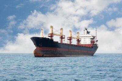 Fotomural Buque de carga seco flotando en el mar