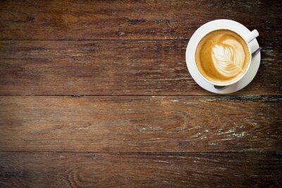 Fotomural café latte en la madera con el espacio.