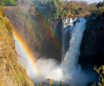 Fotomural Cataratas Victoria. Una vista general de un arco iris. Parque Nacional. Parque Nacional Mosi-oa-Tunya. Y Patrimonio de la Humanidad. Zambiya. Zimbabue. Una excelente ilustración.