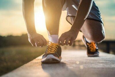Fotomural Cierre de tiro de los zapatos de corredor