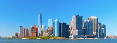 Fotomural Ciudad de Nueva York edificios del distrito calle pared inferior financiero de Manhattan horizonte en un hermoso día de verano con el cielo azul